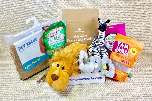 Opened box of Pooch Perks showing animal toys and treats