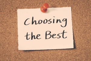 Note pinned to board stating 'Choosing the Best'