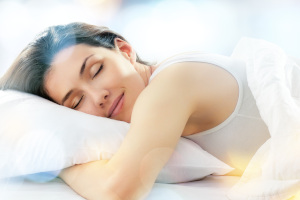 woman sleeping happily in bed