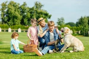 Family in picnic with their dog