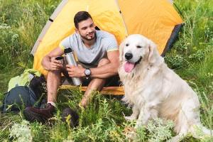 Man camping with his dog
